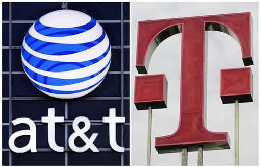 FILE -This March 20, 2011 file photo combo, shows the logos of the communications companies AT&T and Deutsche Telekom. AT&T on Monday, Dec. 19, 2011 said that it is ending its $39 billion bid to buy T-Mobile USA after facing fierce government objections. AT&T's purchase of T-Mobile from Deutsche Telekom of Germany would have made it the largest cellphone company in the U.S. (AP Photo)