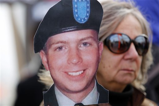 A demonstrator carrying a likeness of Army Pfc. Bradley Manning, marches with hundreds of others outside Ft. Meade, Md., Saturday, Dec. 17, 2011, where Manning is present on base at a military court hearing. Prosecutors began presenting their case that Manning was the source of the WikiLeaks website's collection of U.S. military and diplomatic secrets. ( AP Photo/Jose Luis Magana)