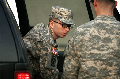 Army Pfc. Bradley Manning is escorted from a security vehicle to a courthouse in Fort Meade, Md., Monday, Dec. 19, 2011, for a military hearing that will determine if he should face court-martial for his alleged role in the WikiLeaks classified leaks case. (AP Photo/Patrick Semansky)