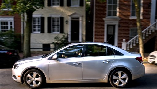 This undated photo provided by General Motors Co., shows 2012 Chevrolet Cruze LT in the Dupont Circle and Georgetown areas of Washington, D.C. General Motors Co.'s U.S. sales rose 13 percent last year as the company recovered from its financial disaster in 2009. (AP Photo/General Motors Co., Steve Fecht)