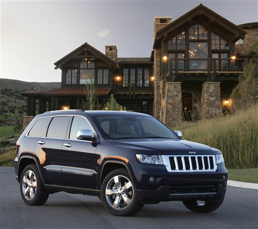 This undated photo provided by Chrysler Group LLC, shows the 2012 Jeep Grand Cherokee. Chrysler led the 2011 sales gains with a 26 percent increase, followed by Nissan at 15 percent, GM at 13 percent and Ford at 11 percent, the companies reported Wednesday, Jan. 4, 2012. (AP Photo/Chrysler Group LLC)