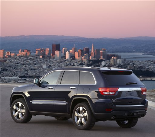 This undated photograph provided by Chrysler Group LLC, shows a 2012 Jeep Grand Cherokee. Chrysler led the 2011 sales gains with a 26 percent increase, followed by Nissan at 15 percent, GM at 13 percent and Ford at 11 percent, the companies reported Wednesday, Jan. 4, 2012. (AP Photo/Chrysler Group LLC)