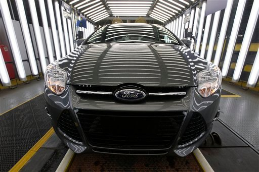 This Dec. 14, 2011 photo, shows a 2012 Ford Focus on the assembly line at the Ford Michigan Assembly plant in Wayne, Mich. Ford brand small car sales were up 25 percent in 2011, with 244,291 vehicles sold, while utilities increased 31 percent with 579,626 sales. (AP Photo/Paul Sancya)