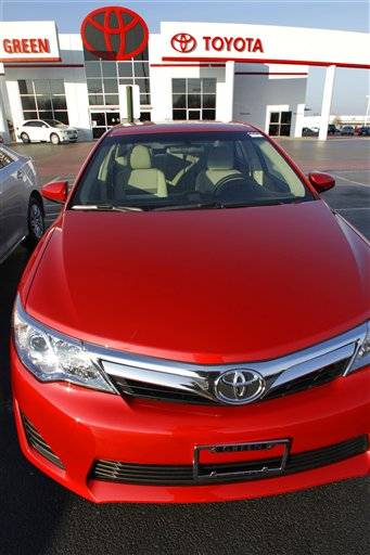 This photo taken Sunday, Dec. 11, 2011, shows a 2012 Toyota Camry for sale at a auto dealership in Springfield, Ill. Toyota Division reported December sales of 152,776 units, up 1.9 percent over 2010.�(AP Photo/Seth Perlman)