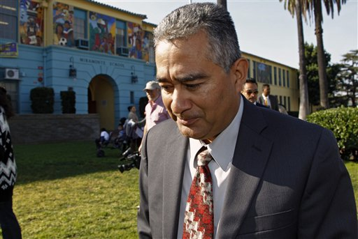 Miramonte Elementary school principal Martin Sandoval walks out to address the media outside the school in Los Angeles on Tuesday, Jan. 31, 2012. Veteran Miramonte Elementary school teacher Mark Berndt, 61, was arrested on charges of lewd conduct with 23 children after a film processor gave police photos showing blindfolded children with their mouths taped and cockroaches on their faces. Berndt, 61, not seen, was arrested Jan. 30, 2012 and remained jailed Tuesday on $2.3 million bail. (AP Photo/Damian Dovarganes)