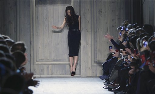 Victoria Beckham appears at the end of her Fall 2012 collection runway presentation on Sunday, Feb. 12, 2012 in New York. (AP Photo/Bebeto Matthews)