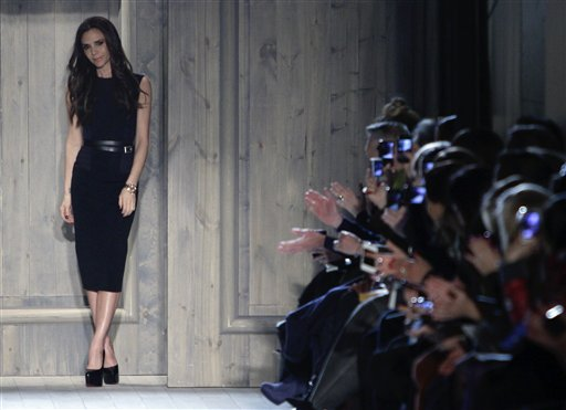 Victoria Beckham appears at the end of her Fall 2012 collection runway show on Sunday, Feb. 12, 2012 in New York. (AP Photo/Bebeto Matthews)