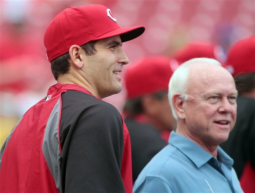Cincinnati Reds' Joey Votto, left, stands Reds general manager Walt Jocketty during batting practice before an exhibition baseball against the Reds Futures minor league team, Tuesday, April. 3, 2012 in Cincinnati. (AP Photo/Tony Tribble)