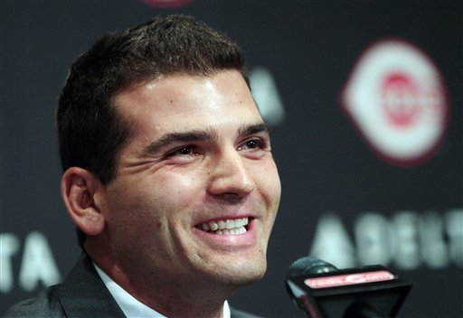 Cincinnati Reds' Joey Votto smiles during a news conference announcing his 12-year deal, Wednesday, April 4, 2012, in Cincinnati. The extension adds 10 years to his previous contract and a club option for 2024. The value of the agreement, the longest guaranteed contract in major league history, is for more than $200 million. (AP Photo/Tony Tribble)
