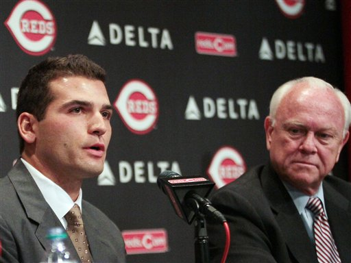 Cincinnati Reds' Joey Votto, left, speaks as Reds general manager Walt Jocketty listens during a news conference announcing Votto's 10-year contract extension with the baseball team, Wednesday, April 4, 2012, in Cincinnati. (AP Photo/Tony Tribble)