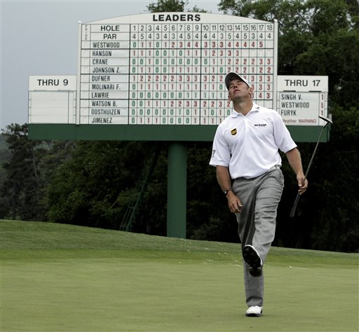 Lee Westwood, of England, reacts after missing a birdie putt on the 18th green during the first round of the Masters golf tournament Thursday, April 5, 2012, in Augusta, Ga. (AP Photo/Matt Slocum)