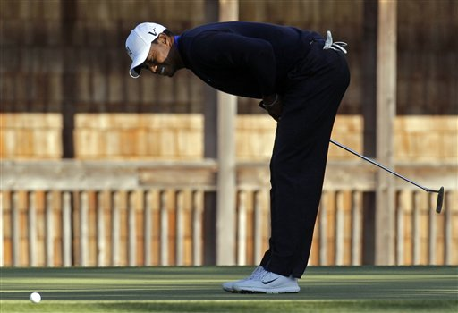Tiger Woods reacts after missing a putt on the 11th hole for a bogie during the second round of the Masters golf tournament Friday, April 6, 2012, in Augusta, Ga. (AP Photo/Charlie Riedel)