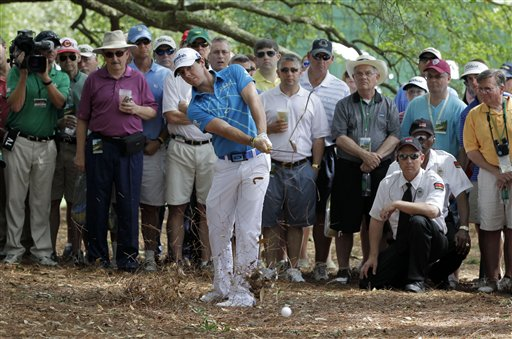 Rory McIlroy, of Northern Ireland, hits out of the rough off the first fairway during the first round of the Masters golf tournament Thursday, April 5, 2012, in Augusta, Ga. (AP Photo/Darron Cummings)