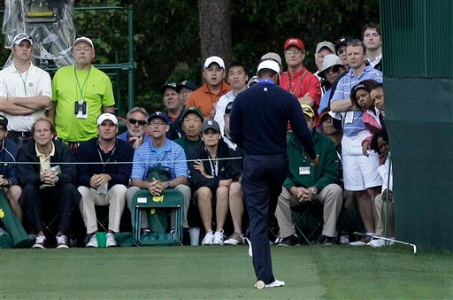 Tiger Woods kicks his club after his tee shot on the 16th hole during the second round of the Masters golf tournament Friday, April 6, 2012, in Augusta, Ga. (AP Photo/Matt Slocum)