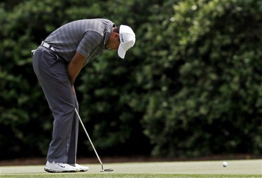 Tiger Woods reacts after missing a birdie putt on the 11th green during the first round the Masters golf tournament Thursday, April 5, 2012, in Augusta, Ga. (AP Photo/David J. Phillip)