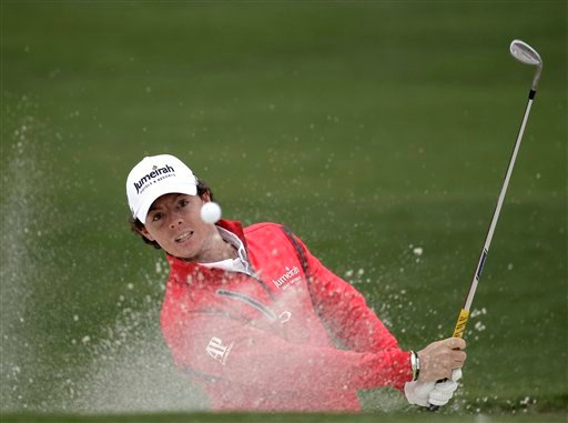 Rory McIlroy, of Northern Ireland, hits out of a bunker on the second hole during the second round the Masters golf tournament Friday, April 6, 2012, in Augusta, Ga. (AP Photo/Chris O'Meara)