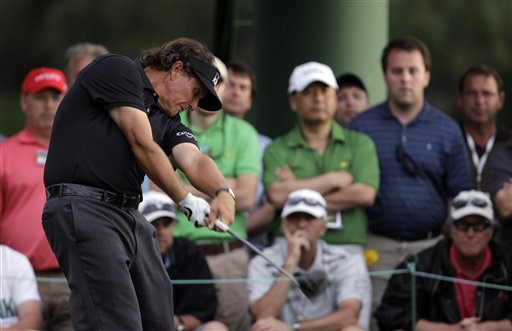 Phil Mickelson tees off on the 18th hole during the first round of the Masters golf tournament Thursday, April 5, 2012, in Augusta, Ga. (AP Photo/Charlie Riedel)